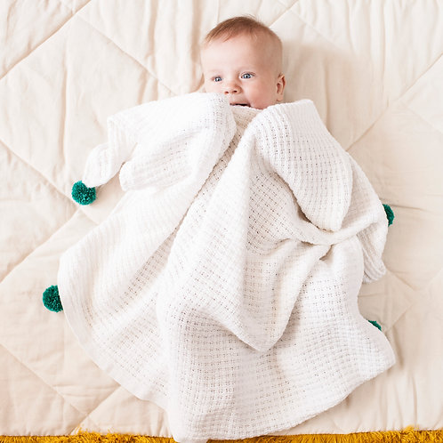 Handmade baby blanket with pom poms by MINICAMP