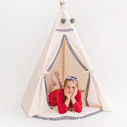 Beige teepee tent with grey pom poms decor