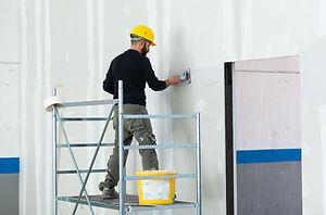 Interior construction, worker plastering