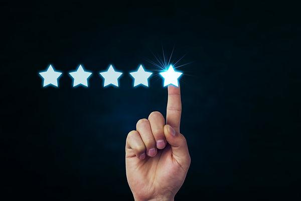 Hand holding five stars..jpg