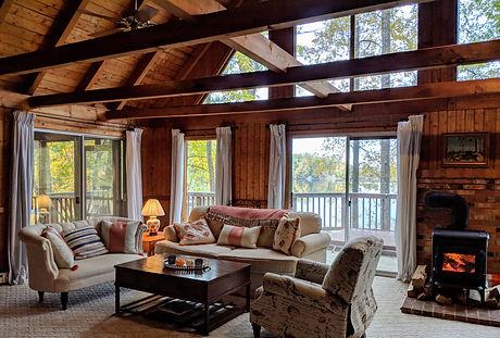 Great room with a fireplace at the Cozy Cabin