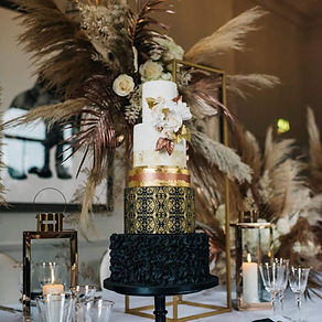 An elegant black, gold and rose-gold art deco wedding cake at The Principal Hotel, York