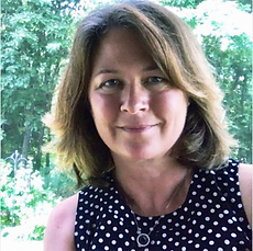 Laurie Head Shot (1).png