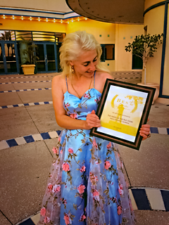 Angel Poses with Best Director Award 10-