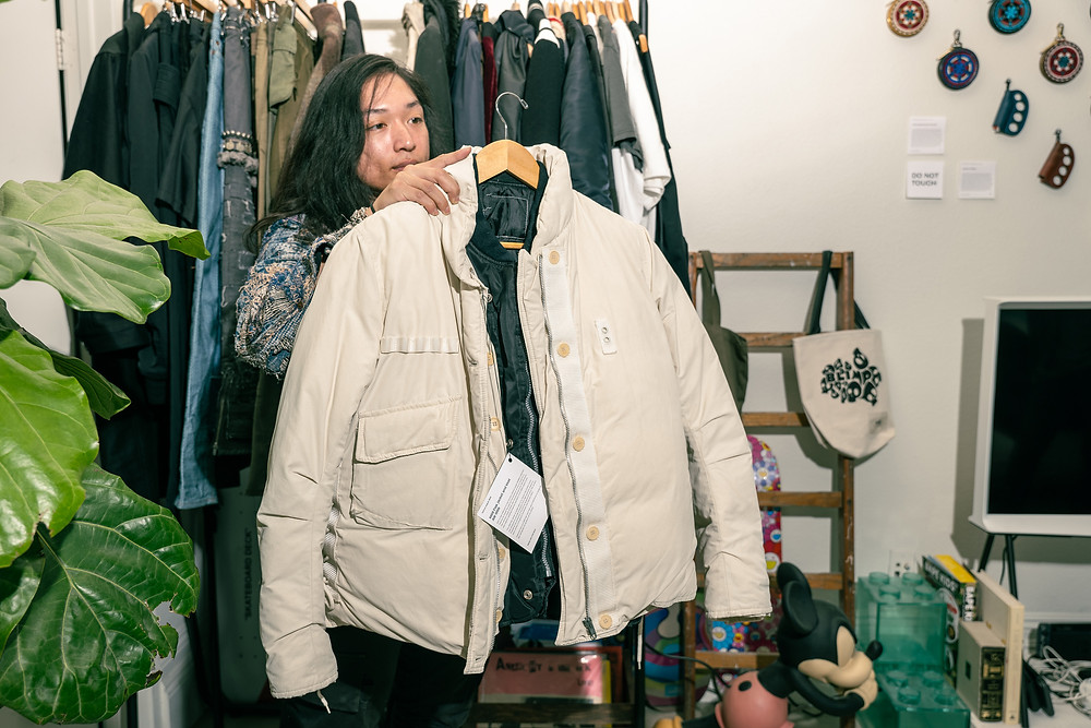 Tony Nguyen of Find Hid.n Archive Fashion Store showcasing a jacket by Helmut Lang