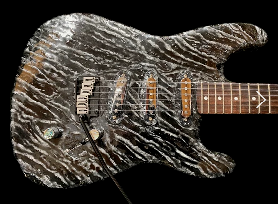 'Lucas', a custom-made rock guitar made by EddieA, featuring stripes in white.