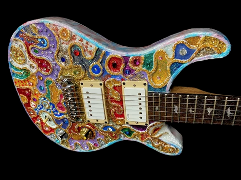 A custom-made guitar called Candy, featuring various patterns and colors.