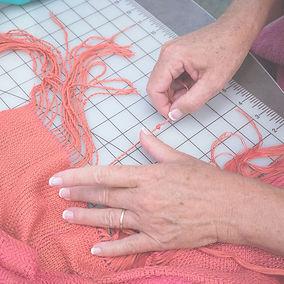 Lisa knotting fringe strand.jpg