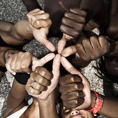 A group of mixed race people with hands