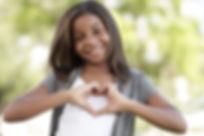 Girl making a heart shape.jpg