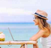 woman-working-laptop-beach.jpg