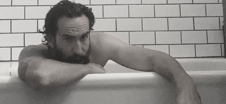 Daniel Keith acting in bathtub