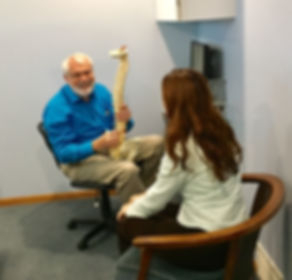 Dr. Gary Hutchinson treating back pain