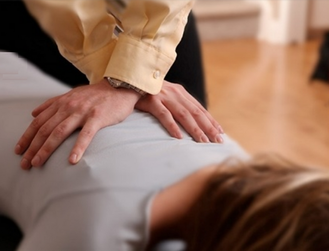 Chiropractor adjusting a woman's back