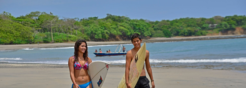 Surfing at Playa Lagarto.
