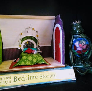 A magical shelf display perfect for a nursery or bookshelf