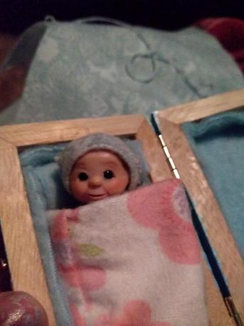 Miniature elf close up on face