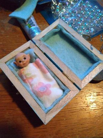 Miniature elf in box