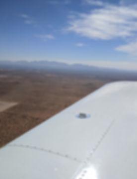 view of desert west of KLRU from Piper Cherokee