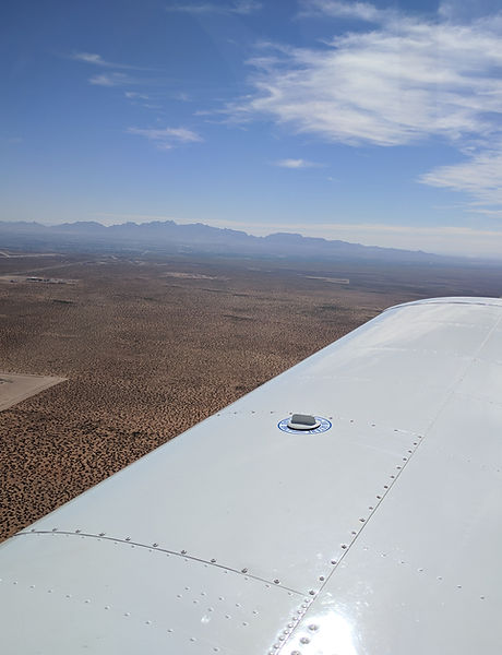view of desert west of KLRU from Piper Cherokee