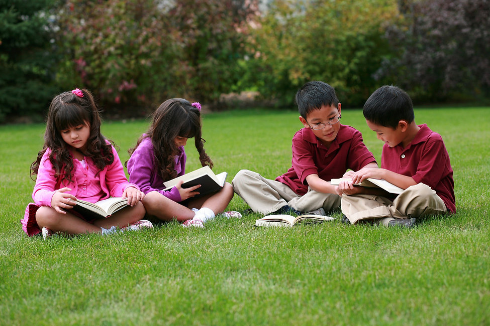 Four Children Reading on Grass.jpg