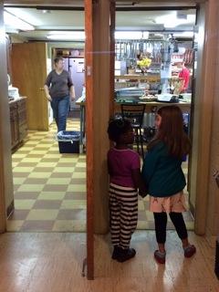 Girls in kitchen door