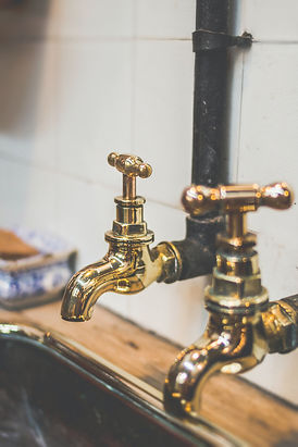 shallow-focus-photography-of-gold-faucet