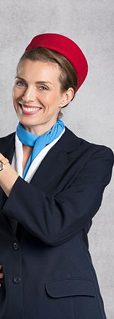 Portrait of air hostess pointing against