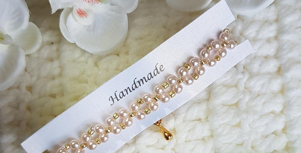 Handgemaakte armband met parels en kralen - Roze/Goud