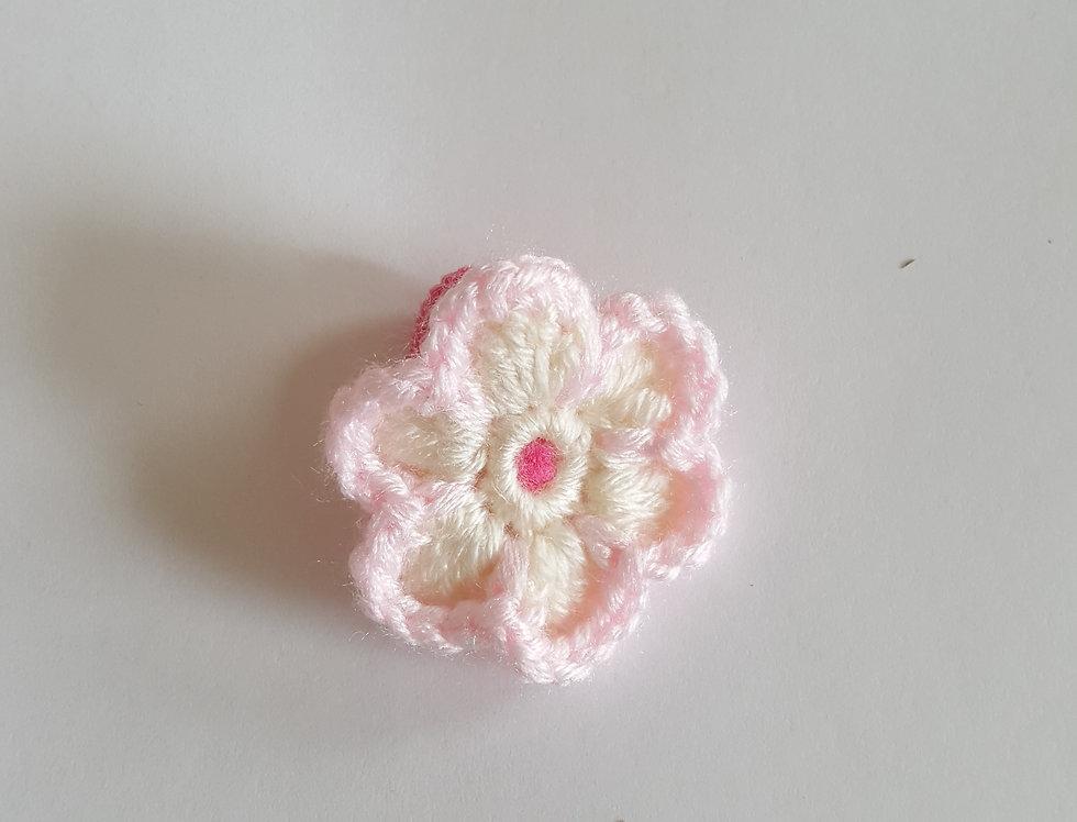 elastiek met gehaakte bloem - wit/roze