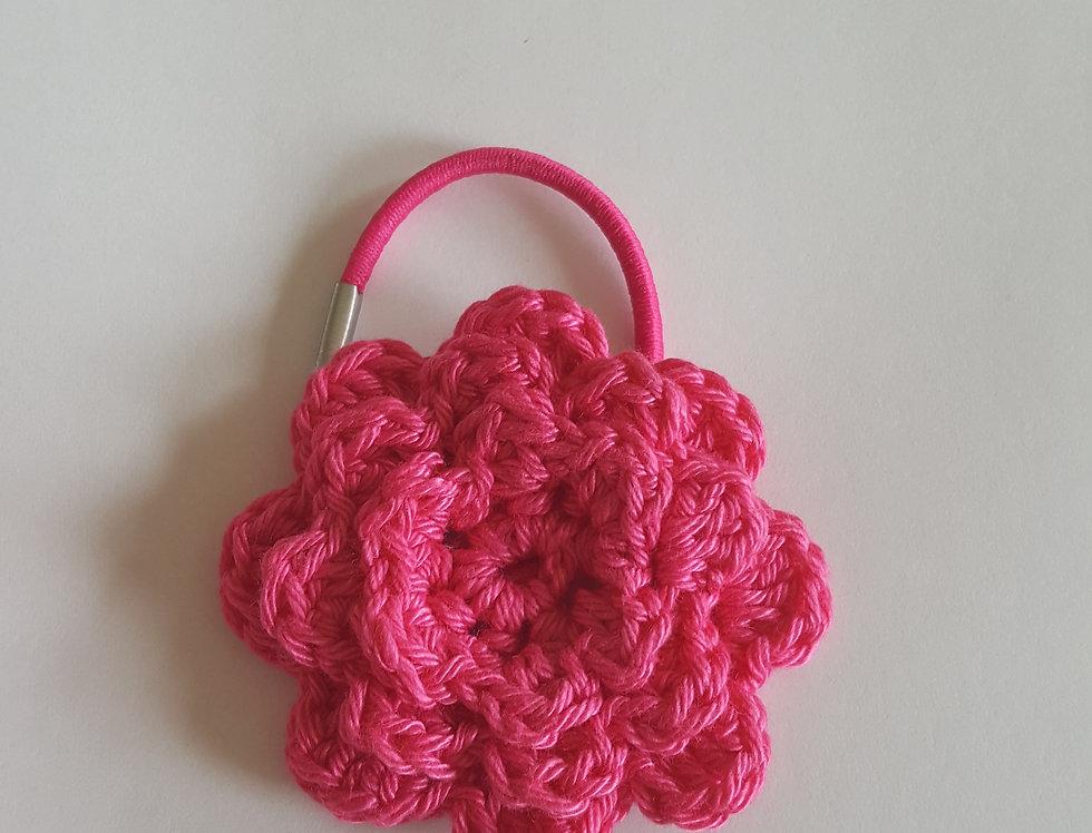 elastiek met gehaakte bloem