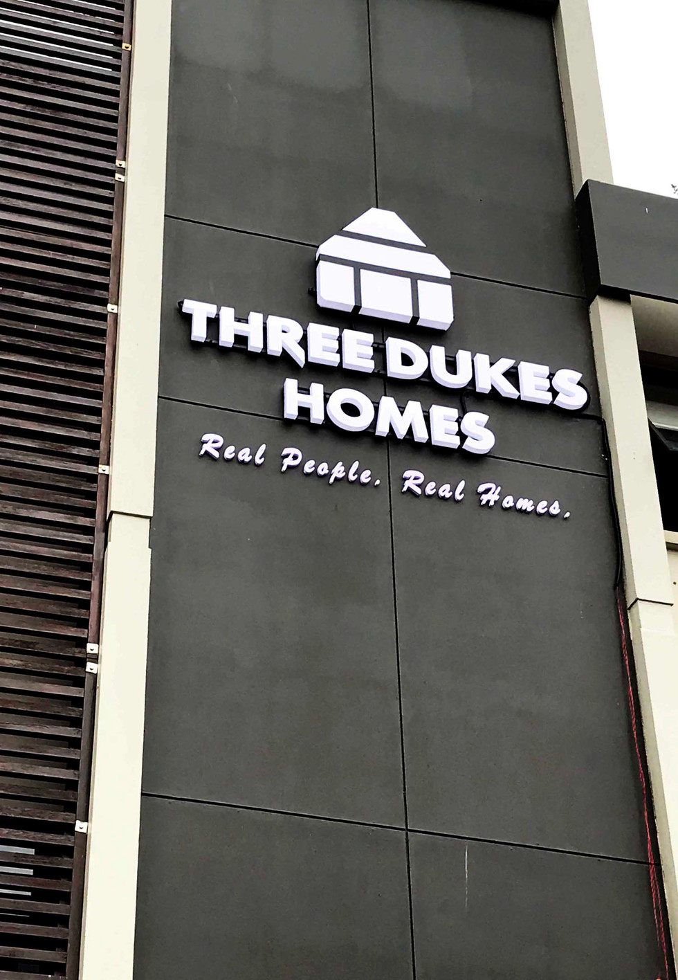 Three Dukes Homes LED Building Signage.j