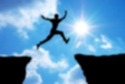 bigstock-Man-jump-through-the-gap-Elem-1
