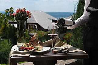 bigstock-The-Waiter-Pours-The-Wine-Into-