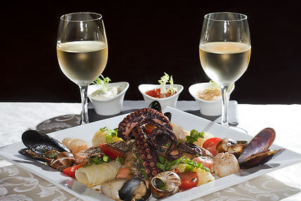 mouthwatering seafood with white wine at many great local restaurants by San Franciscan chaef