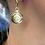 Thumbnail: Dangling Circle Diamond Burnished Gold Earrings