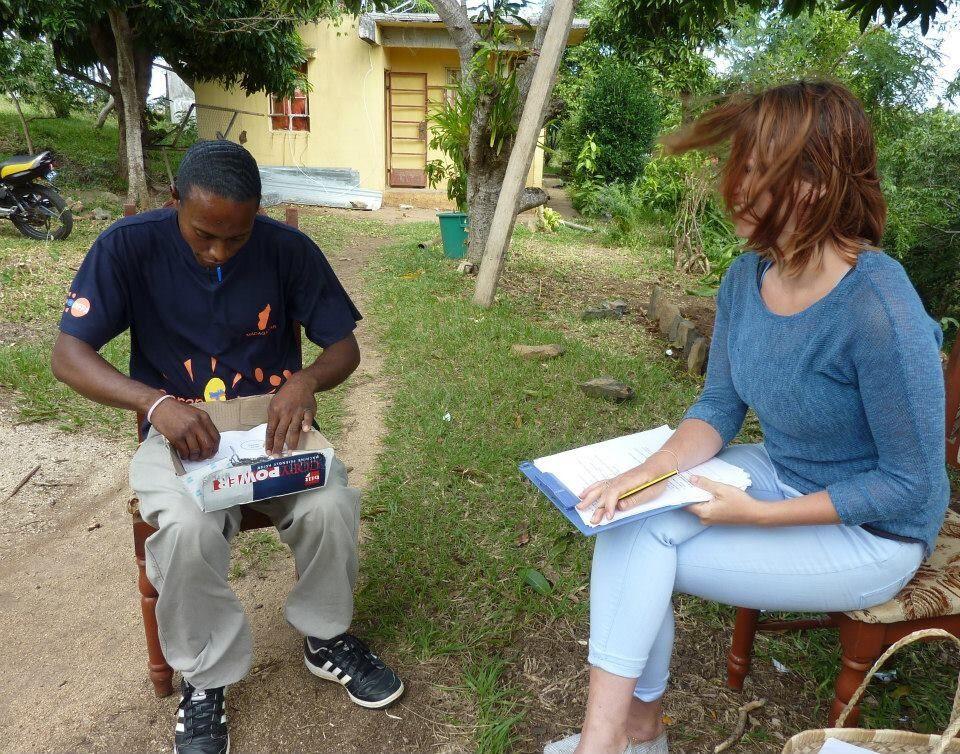 A woman interviews a man.