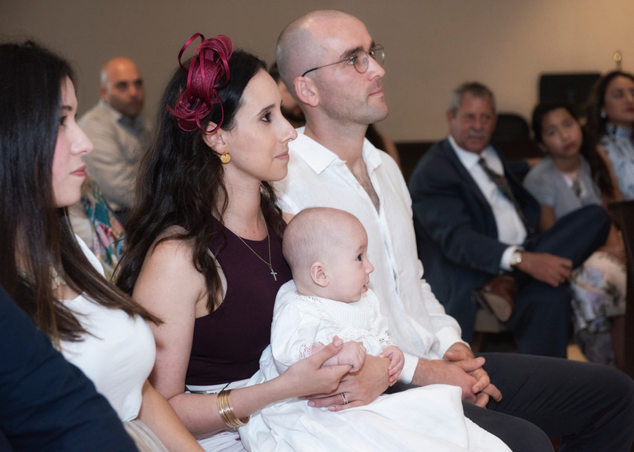 Henry very attentive during his baptism