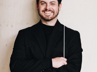 The Scoop: assistant band director Mr. Ray