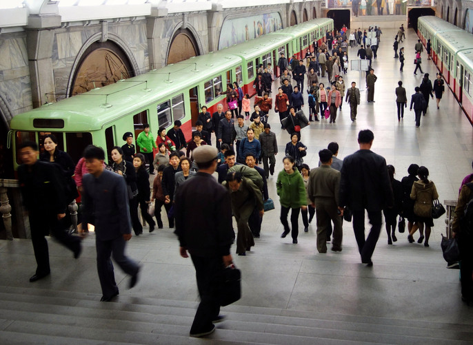 Pyongyang, 2016. Subway system said to be the furthest underground anywhere in the world. You're not supposed to take pictures of the tunnels. Civilians very shy. One of my best crowd scenes from DPRK and very much my favorite N Korea pic. Taken with a Sony DSC-RX100