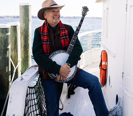 Bud on white boat with banjo.jpg