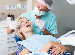 Male dentist with female patient during