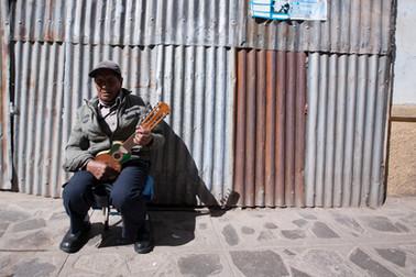Man playing charango in Puno