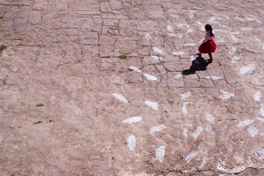 Girl on a square on Taquile Island