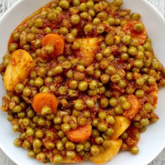 Casserole of peas with carrots and potatoes