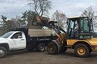 Loading mulch into truck