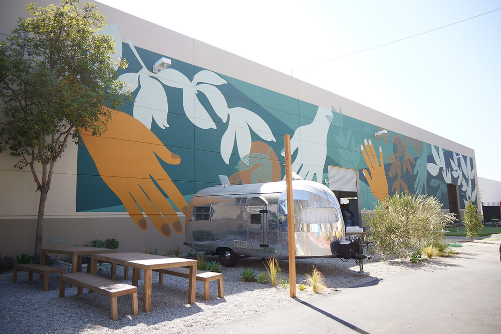 Mural outside Avocado Mattress factory in Fullerton, CA by Lina Cholewinski
