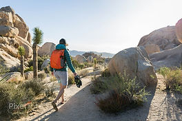 pv-lg-woman-with-a-backpack-hiking-to-a-