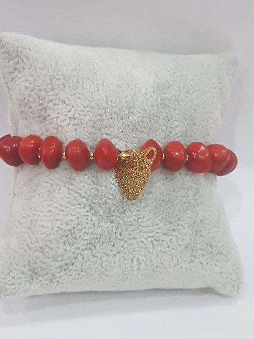 Bracelet graines d'eglise avec charme tete de Panthère dorée