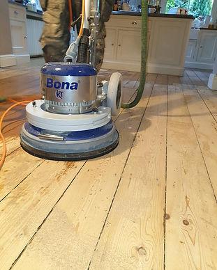 Floor being sanded